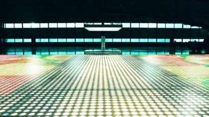 LG's Guinness World Records title-winning light bulb-based display laid out on the floor of a large auditorium.