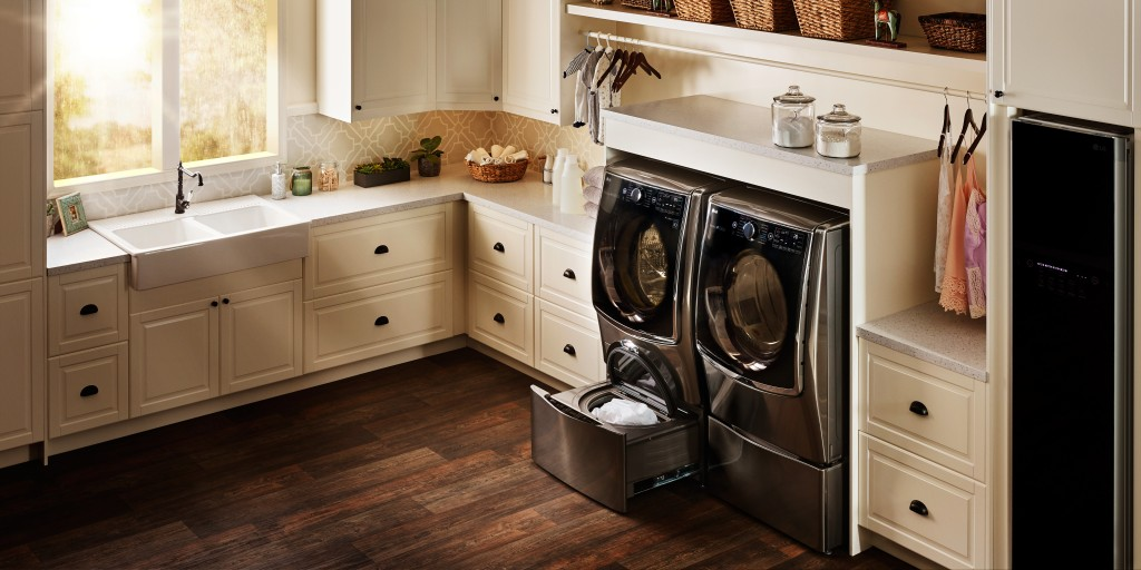 LG Styler and set of TWINWash™ washing machine and dryer fitted into a utility room.