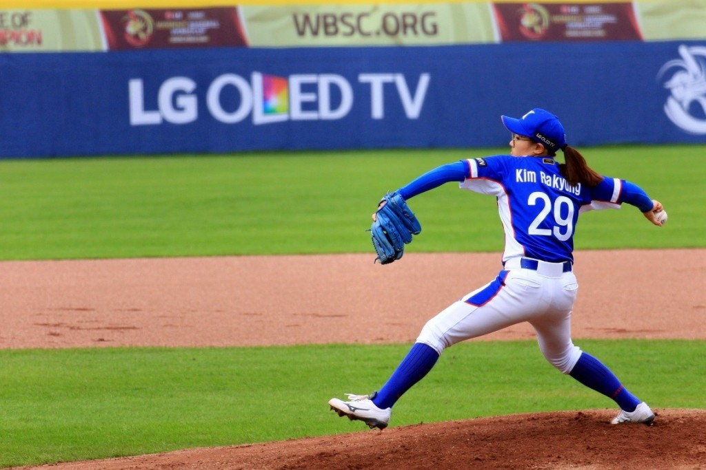 South Korean player pitching with LG OLED TV logo visible in background