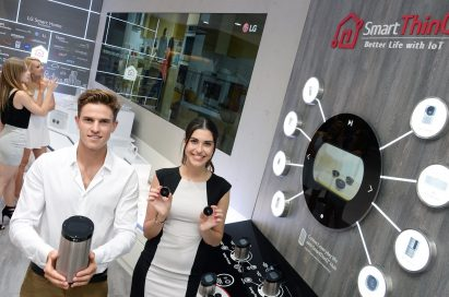 Male and female models holding SmartThinQ™ Hub and SmartThinQ™ Sensors in their hands at LG booth in IFA 2019