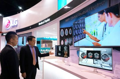 An LG staff member explains the LG Clinical Review Monitor to a visitor at RSNA® 2016