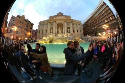 App interface of LG 360 CAM shown capturing 360-degree video footage of people at a fountain