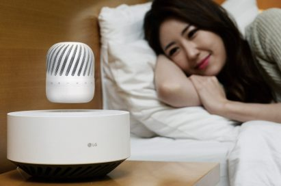 A woman leaning her head on a pillow while gazing upon the LG Levitating Portable Speaker