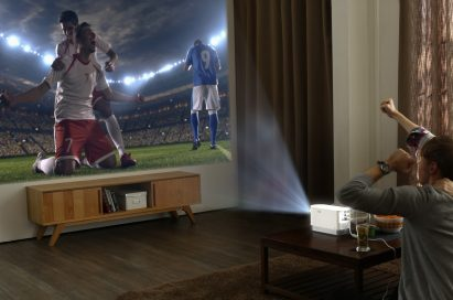Two men watching sports with their LG ProBeam