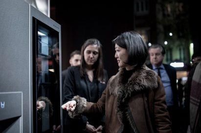 A visitor touches LG SIGNATURE InstaView™ Door-in-Door™ Refrigerator