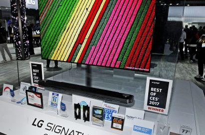 LG's revolutionary new LG SIGNATURE W7 OLED 4K TV on display with its numerous awards placed in front at CES 2017.