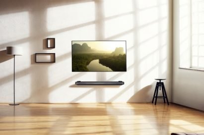 A minimalist living room scene with the LG SIGNATURE OLED TV W fitted on the wall