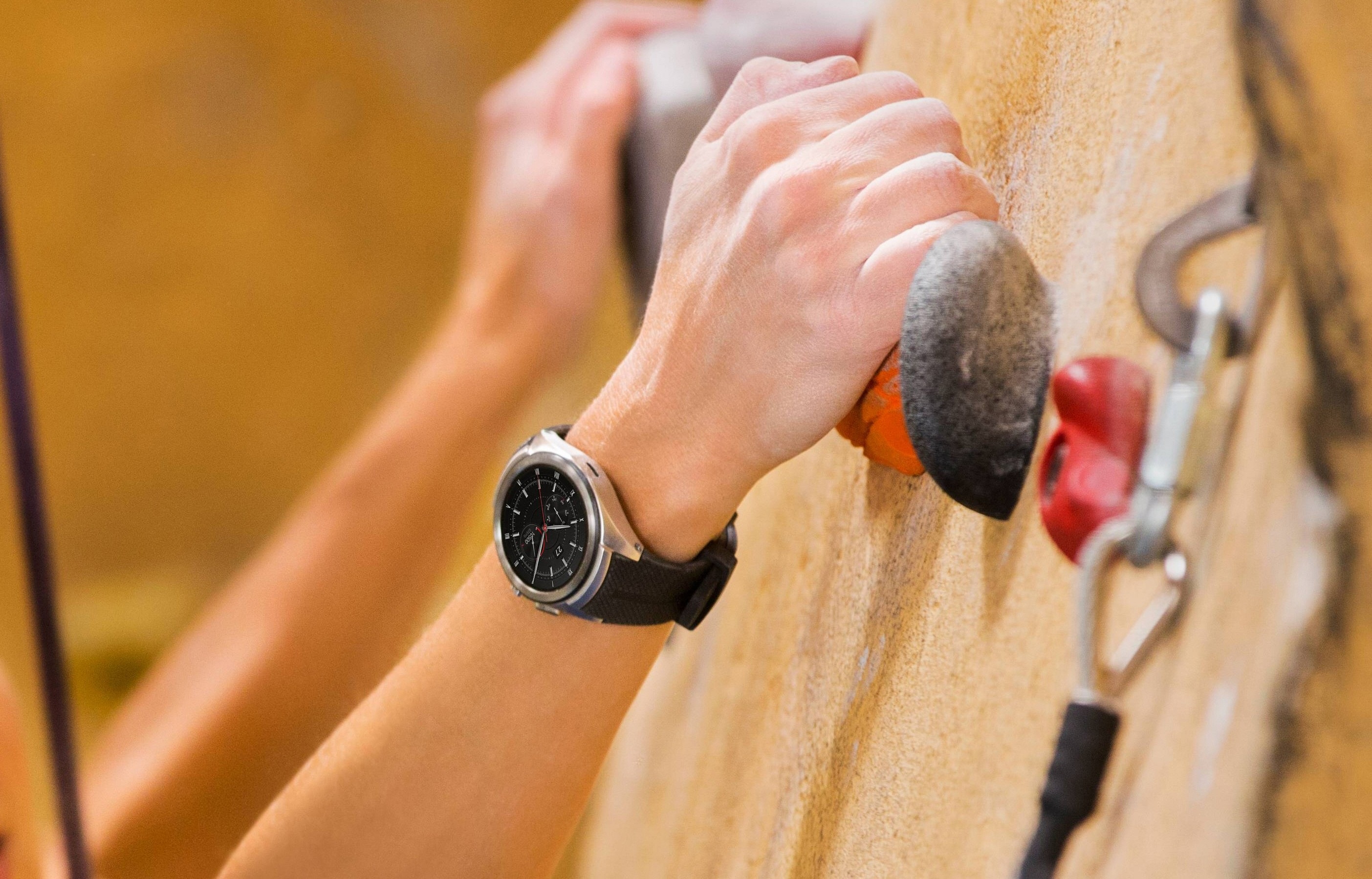 LG Watch Urbane 2 shown on wrist of person doing in-door rock climbing