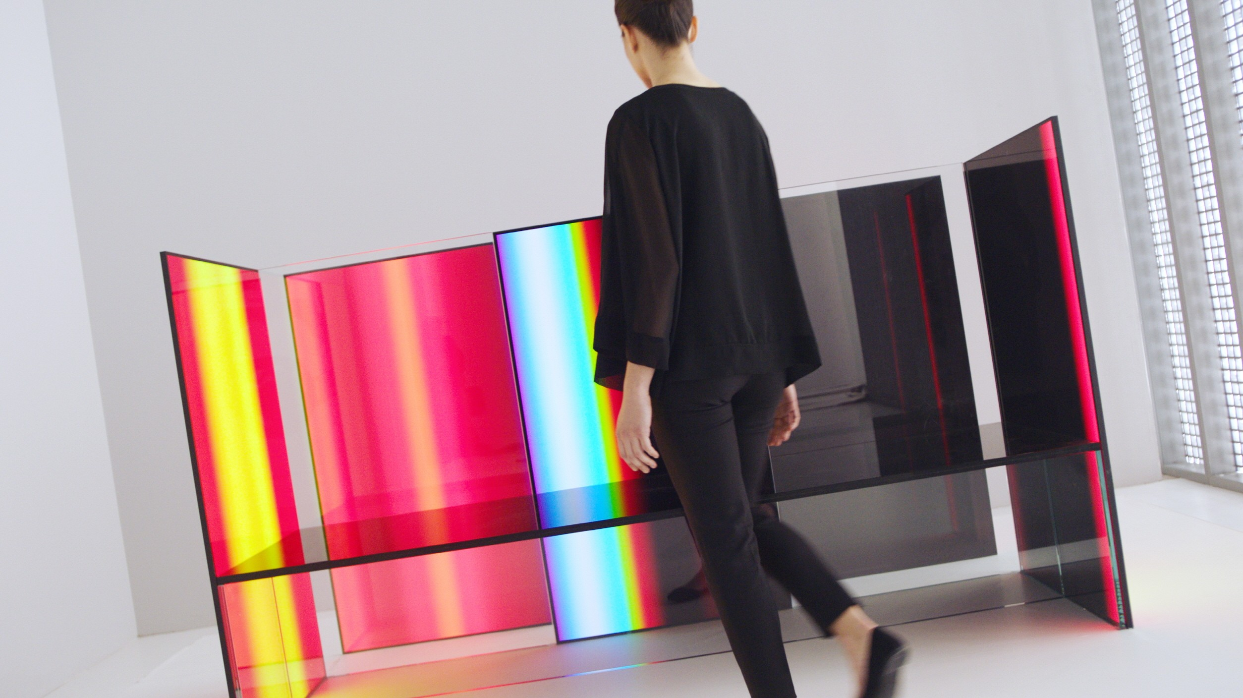 A woman beholds Tokujin Yoshioka's OLED panel installation artwork.