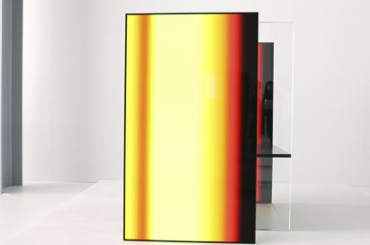 A front close-up of one of the OLED panel installations found inside Tokujin Yoshioka's art exhibition, currently displaying vibrant yellows and reds.