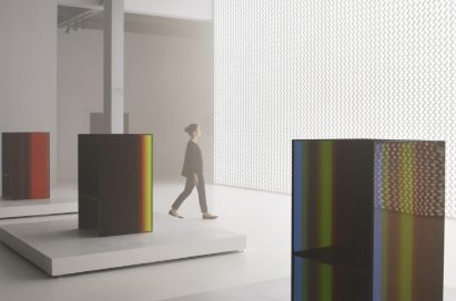 "A side view of a woman walking through the critically acclaimed ""TOKUJIN YOSHIOKA x LG: S.F_Senses of the Future"" installation."