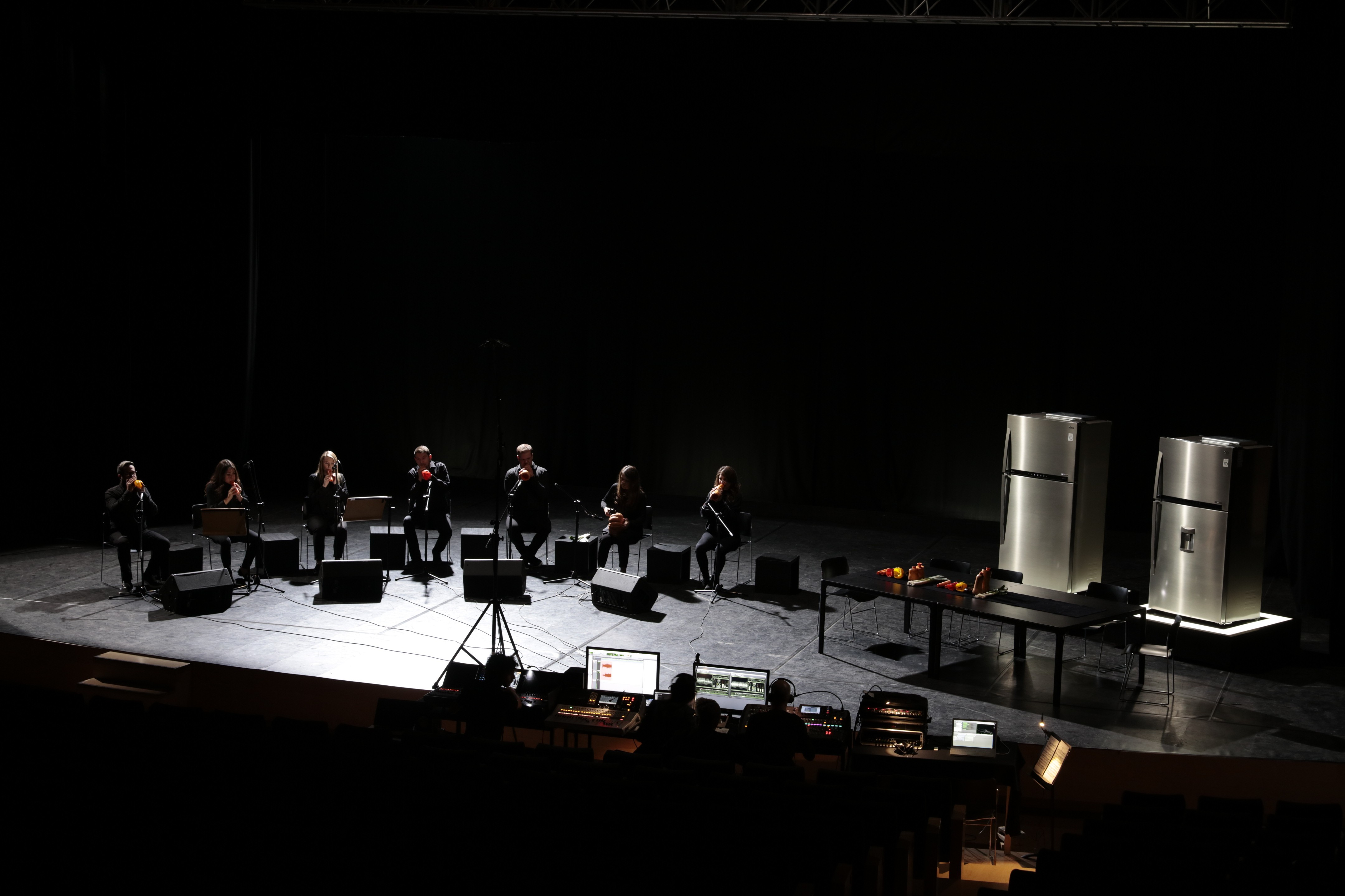 A wide-angled view of the London Vegetable Orchestra performing next to two of LG's advanced refrigerators.