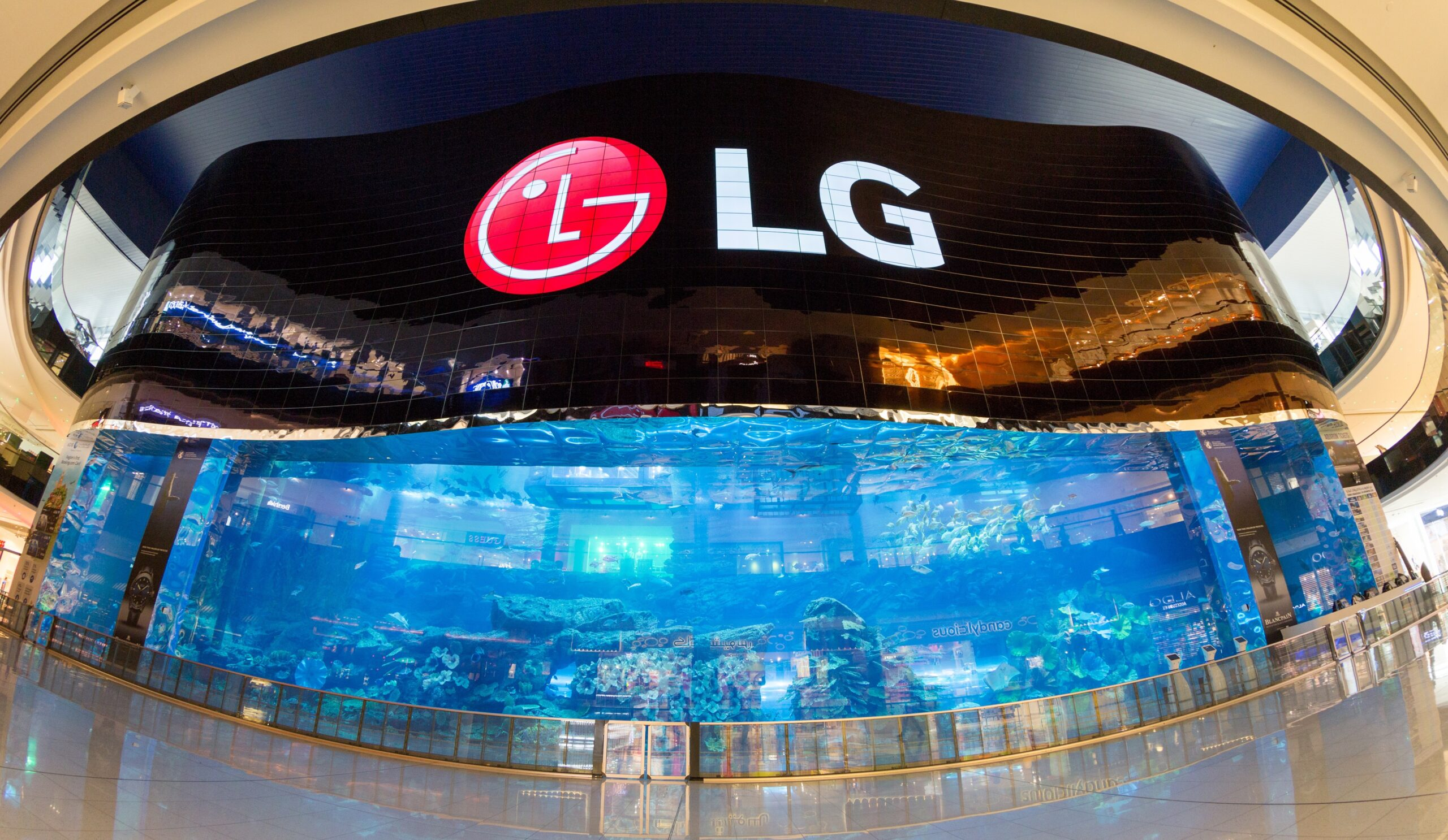 A gigantic LG OLED video wall signage displaying the logo of LG at the Dubai Aquarium