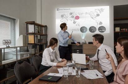 A work team use the LG Probeam Projector for their meeting in the office