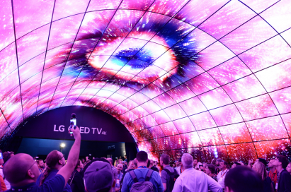 Visitors to LG's booth at IFA 2017 admiring and taking photos of the LG OLED tunnel