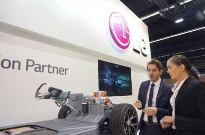 A lady and gentleman discuss LG Vehicle Component technology in front of the LG booth at the Frankfurt Motor Show.