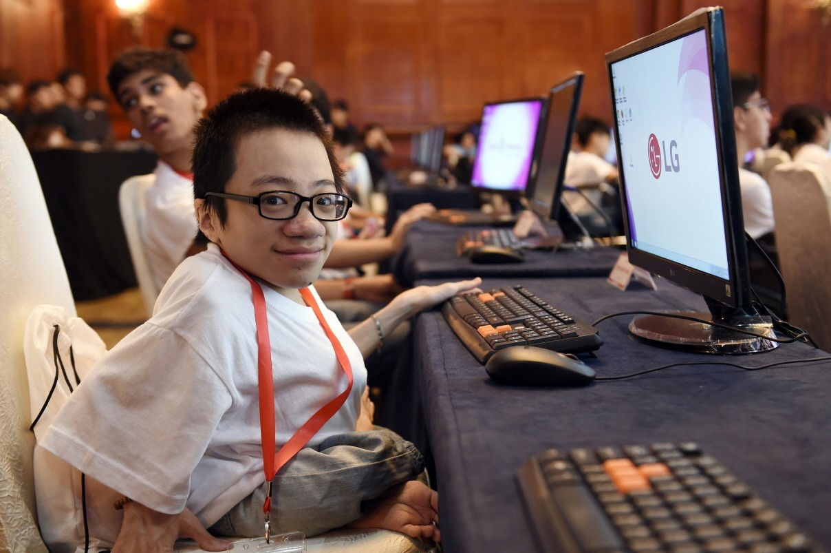One of the participants smiles at the camera before beginning the challenge.