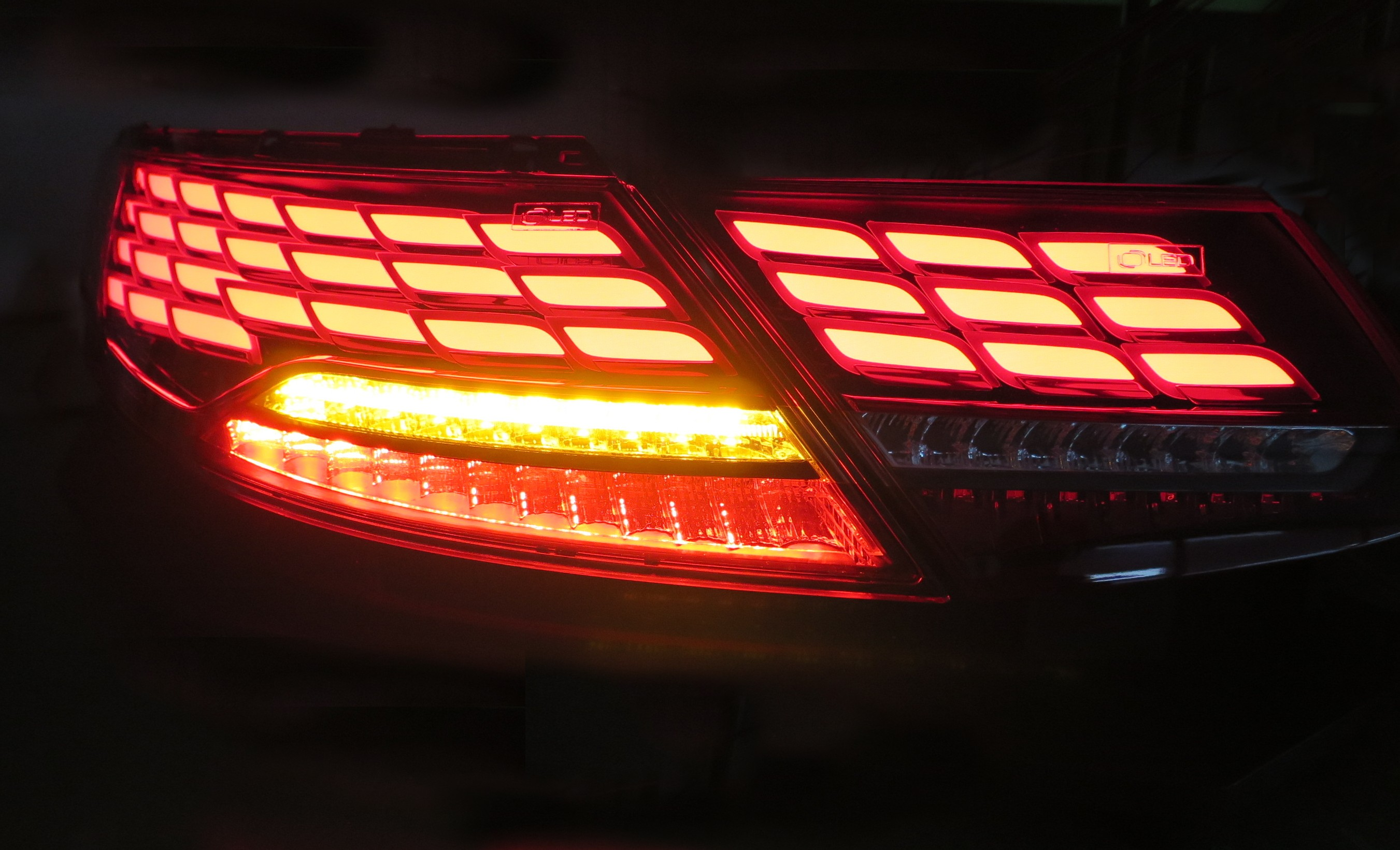 The same vehicle rear lamp displayed in the dark to show its brake and car indicator lights in action at the Frankfurt Motor Show.