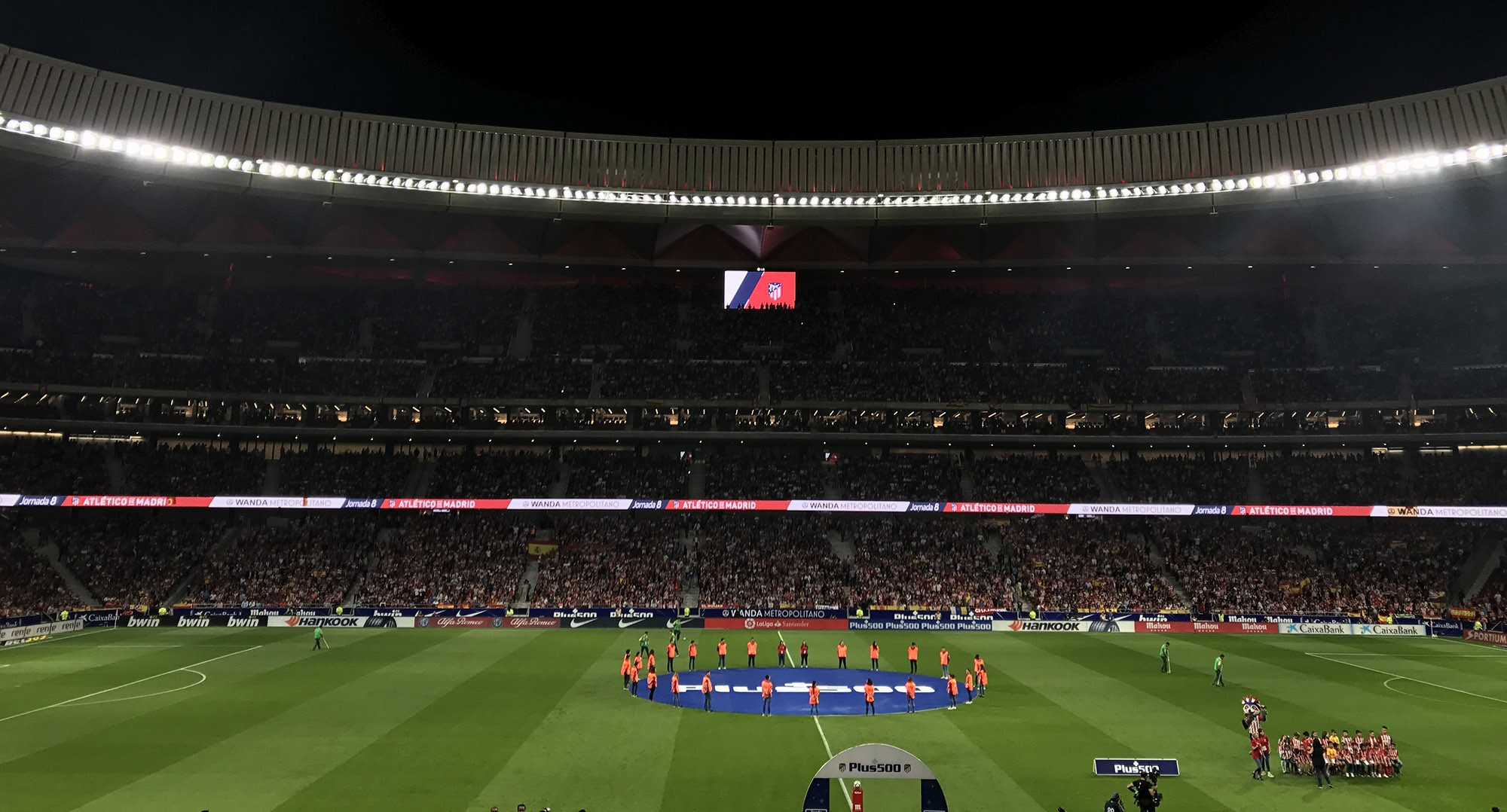 A wide view of Atletico de Madrid's football stadium with LG's signage in the background