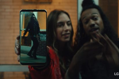 An image from the video clip shows woman standing next to a man while she holds LG V30 out towards the screen