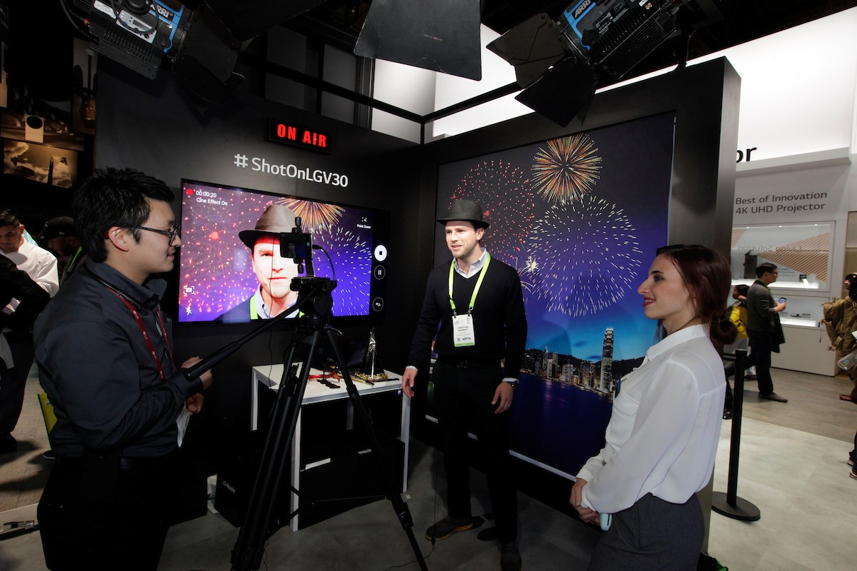 LG staff demonstrate the enhanced cameras of the LG V30 smartphone