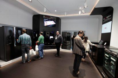 CES attendees examine products and displays in the LG InstaView Door-in-Door Refrigerator zone