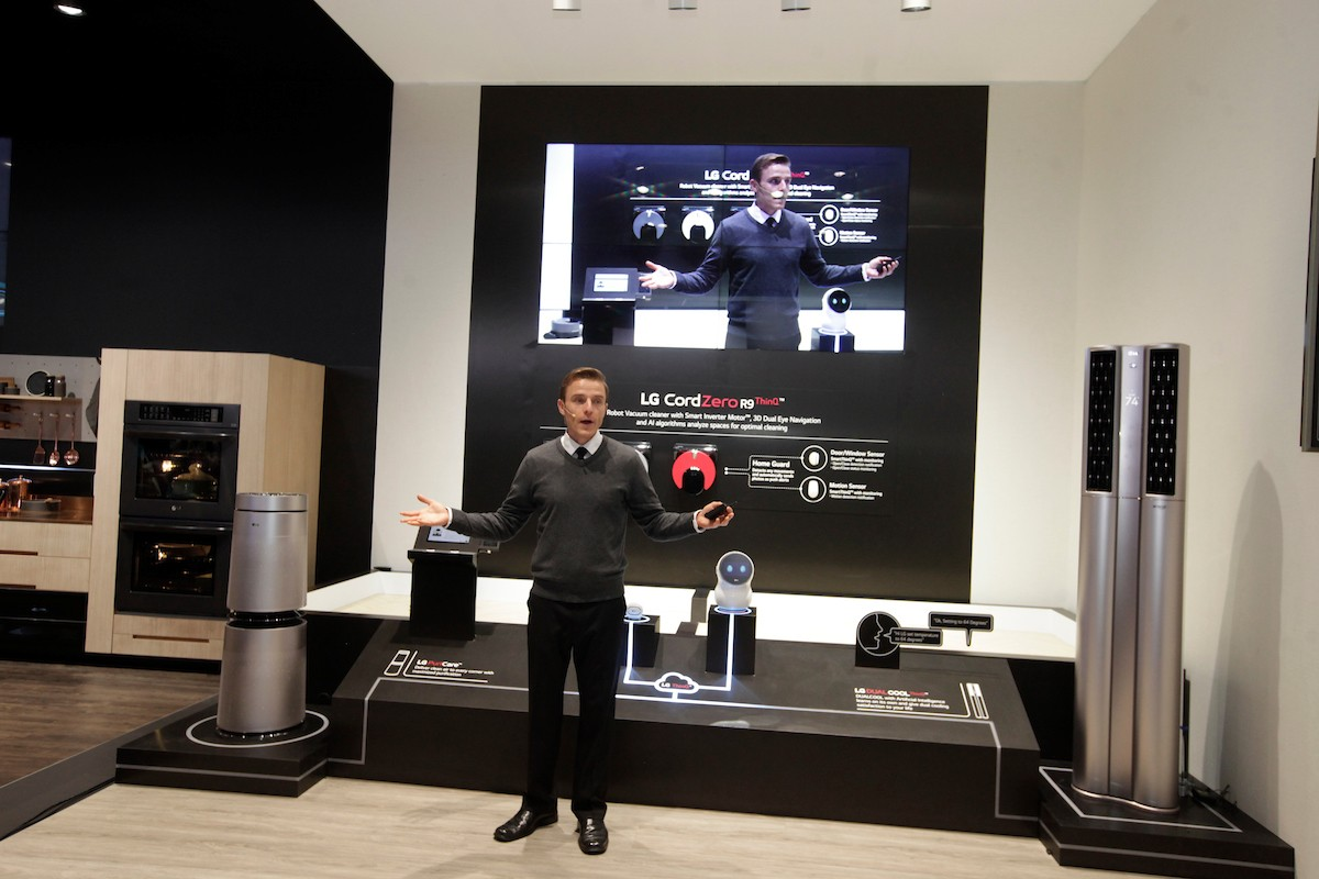 A staff member rehearses his demonstration of the connected home technology powered by LG's ThinQ AI platform at LG's CES booth.