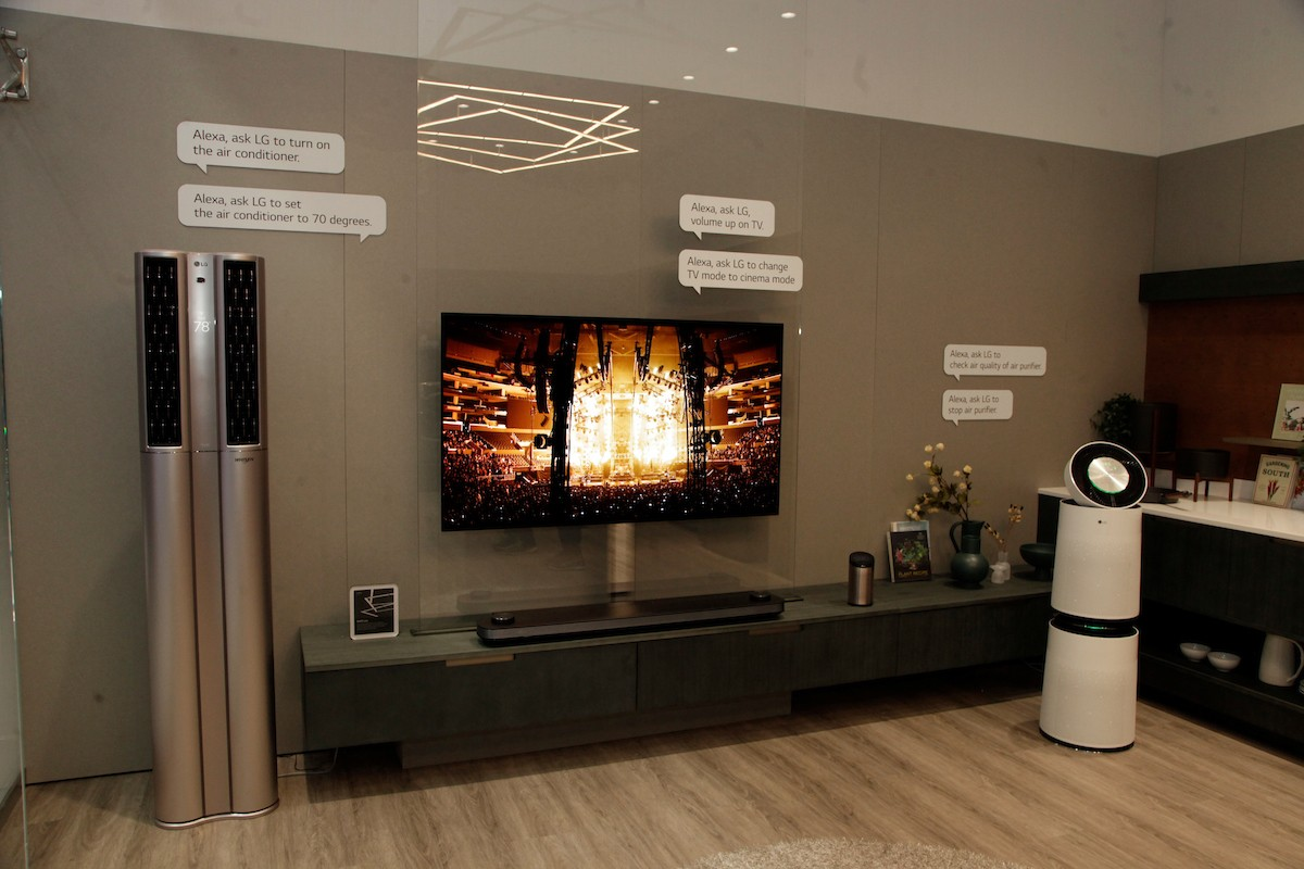 LG's connected home devices, including LG SIGNATURE OLED TV W, LG DUALCOOL ThinQ™ Stand Inverter air conditioner and LG PuriCare air purifier, on display at LG's CES 2018 booth.
