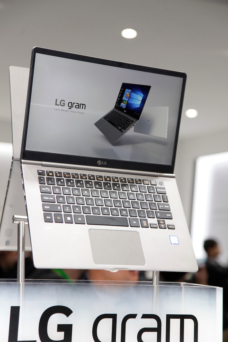 Closeup of the LG gram promotional stand at CES 2018, with two LG gram laptops back to back with the display open.