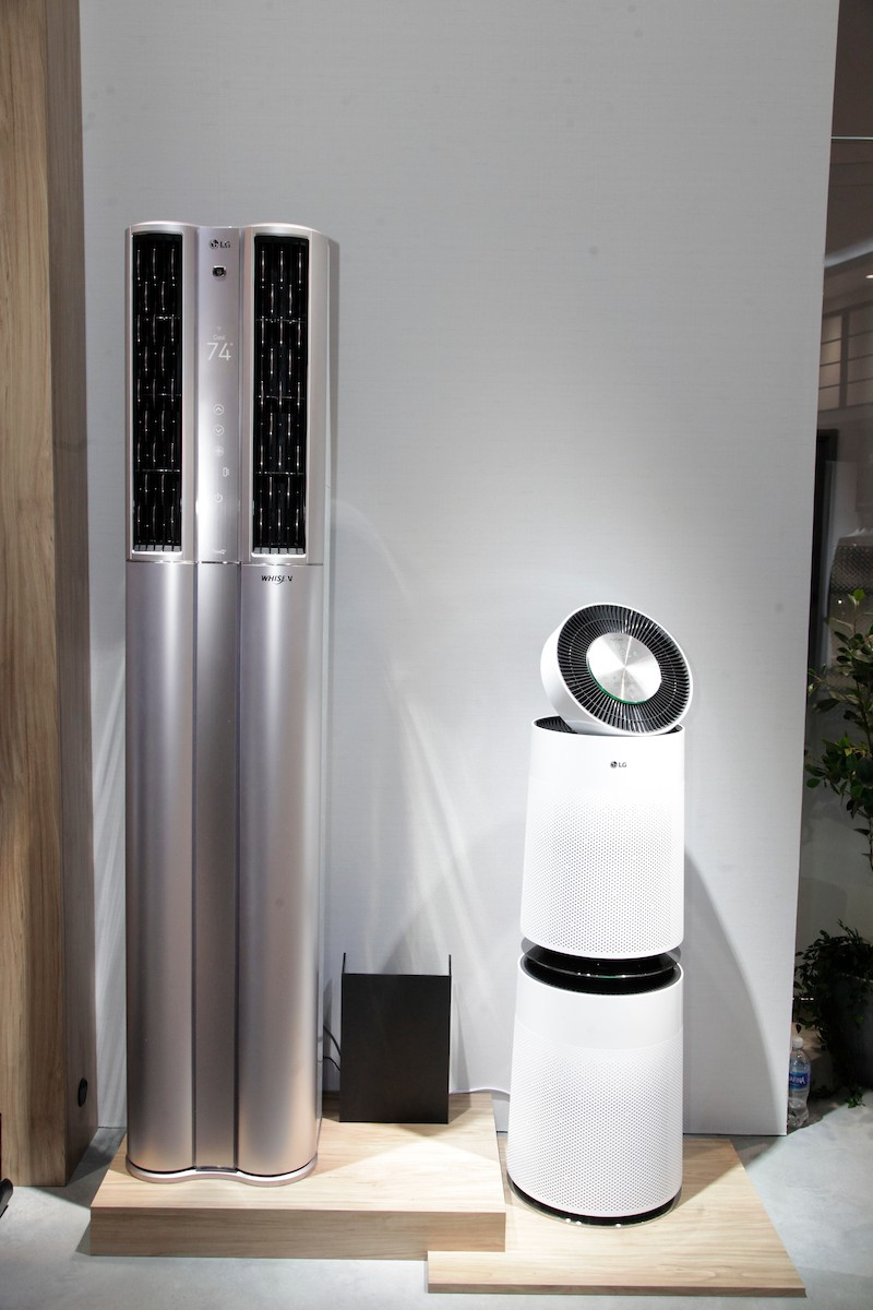 Front view of the LG DUALCOOL ThinQ™ Stand Inverter air conditioner and the LG PuriCare air purifier
