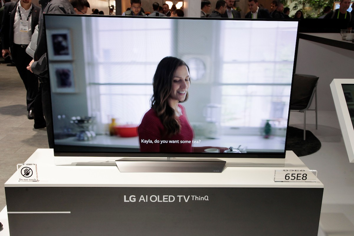 A closeup of the LG AI OLED TV ThinQ positioned on the promotional stand at the LG booth, CES 2018