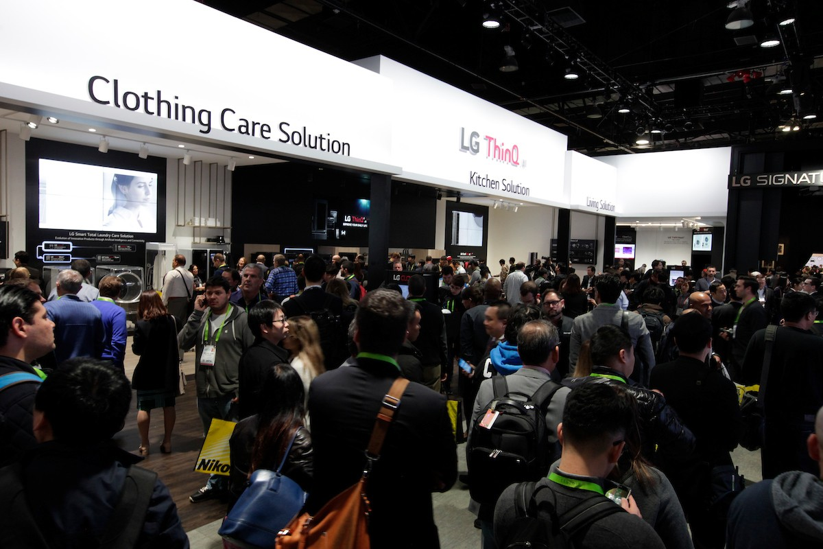 Many visitors taking a walk around LG's AI-enabled home appliances in the LG ThinQ AI zone of the company's CES booth