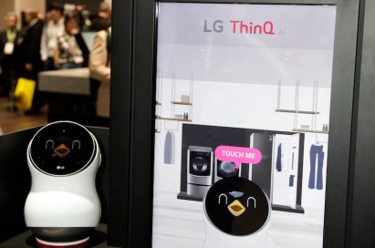 Front view of the LG CLOi Hub Robot and its touchscreen banner that introduces the key features of LG's ThinQ AI platform and robots