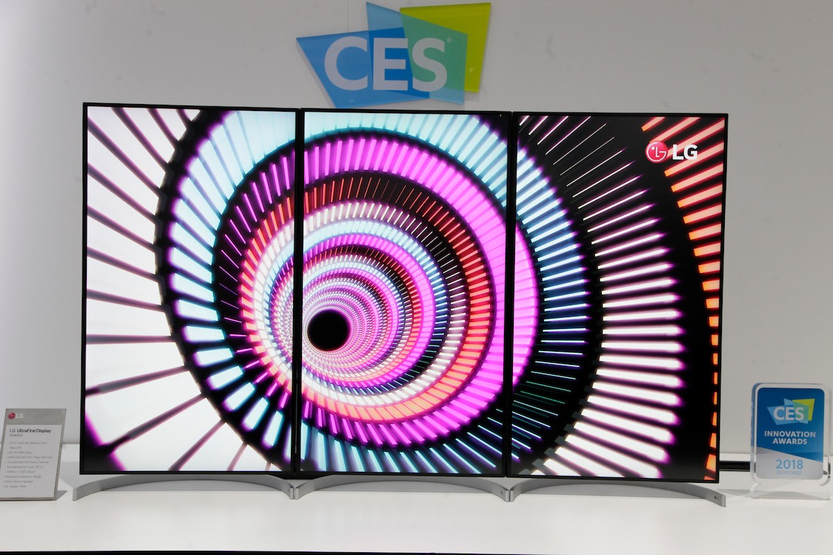 Front view of three 32-inch UltraFine Displays in their portrait mode to form one large 55-inch screen, which stands next to a 2018 CES Innovation Award