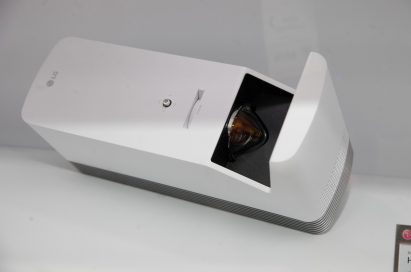 Top view of LG's 4K UHD Projector HU80K placed next to its nameplate