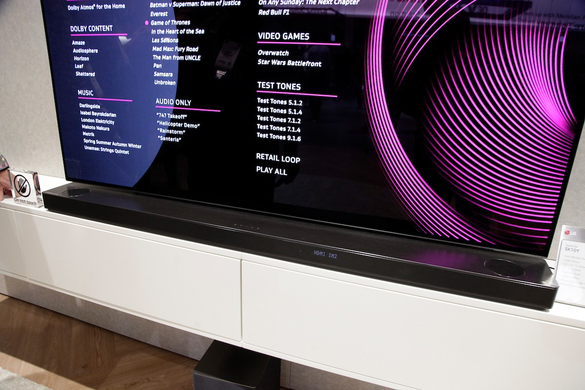 Front view of the LG SoundBar SK10Y placed below an LG TV