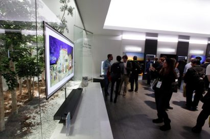 Visitors taking a closer look at the LG SIGNATURE OLED W's prototype