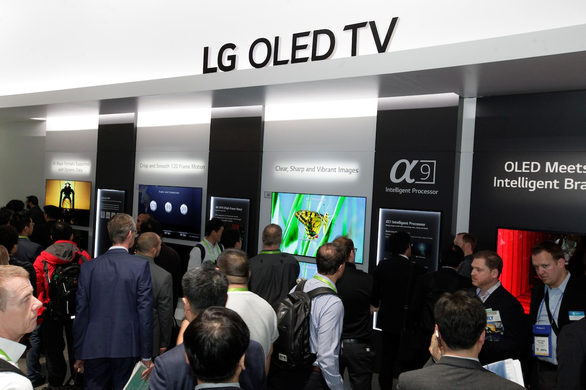 Many visitors taking a walk around the LG OLED TV zone of the company's CES booth