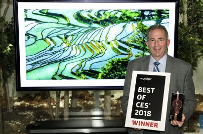 Tim Alessi, LG Electronics' USA head of Product Marketing for Home Entertainment products, poses with two awards, one being Engadget's Best of CES 2018 certificate.