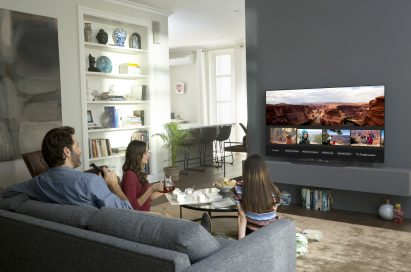 A family browse images on their AI-enabled LG TV in the living room
