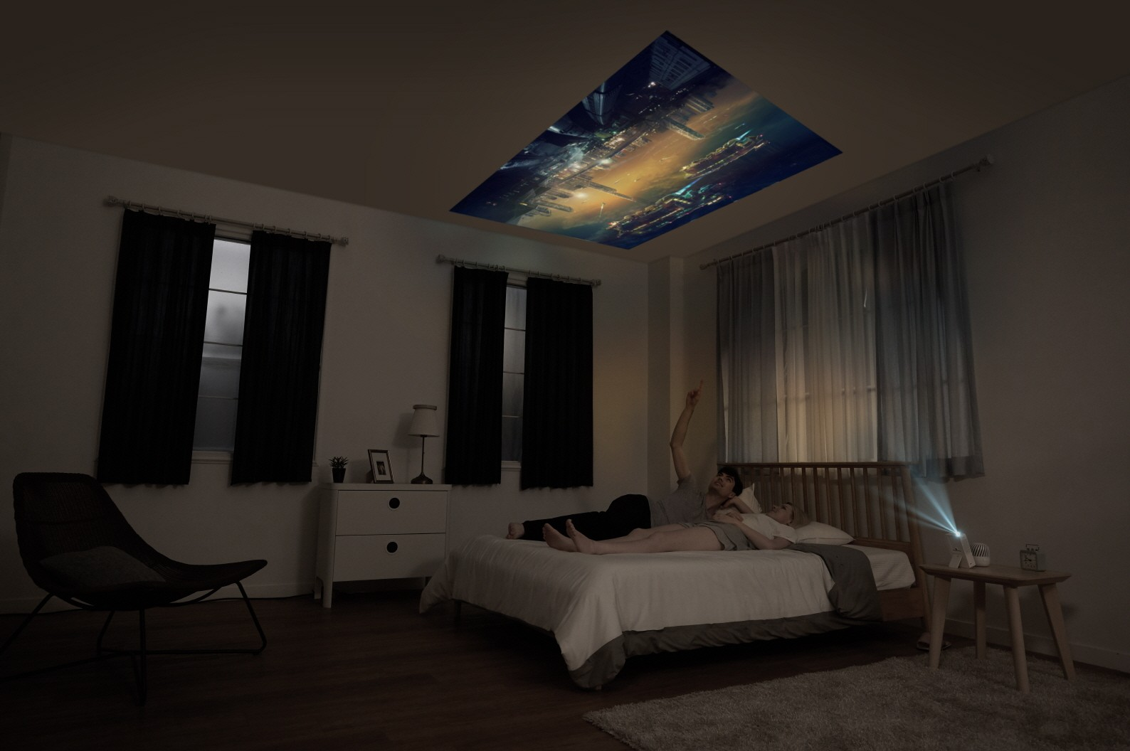 A couple lying in bed while watching a movie projected on the ceiling by the LG MiniBeam Projector