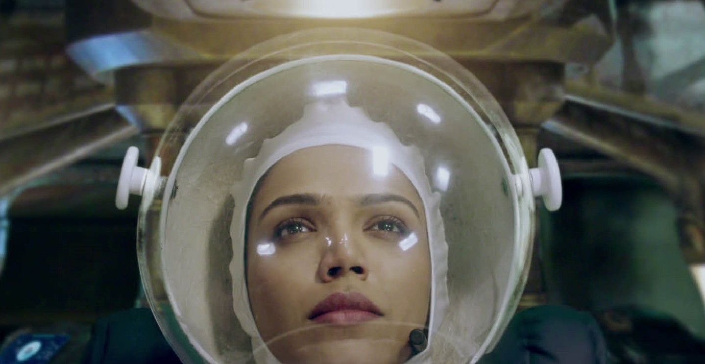 """A screenshot of LG India's """"Astronaut"""" video, a woman wearing the astronaut suit is waiting for the departure of the spaceship."""