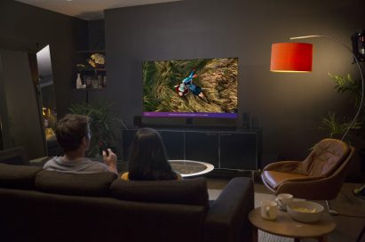 A couple experiencing the LG ThinQ Cinema Mode in their living room