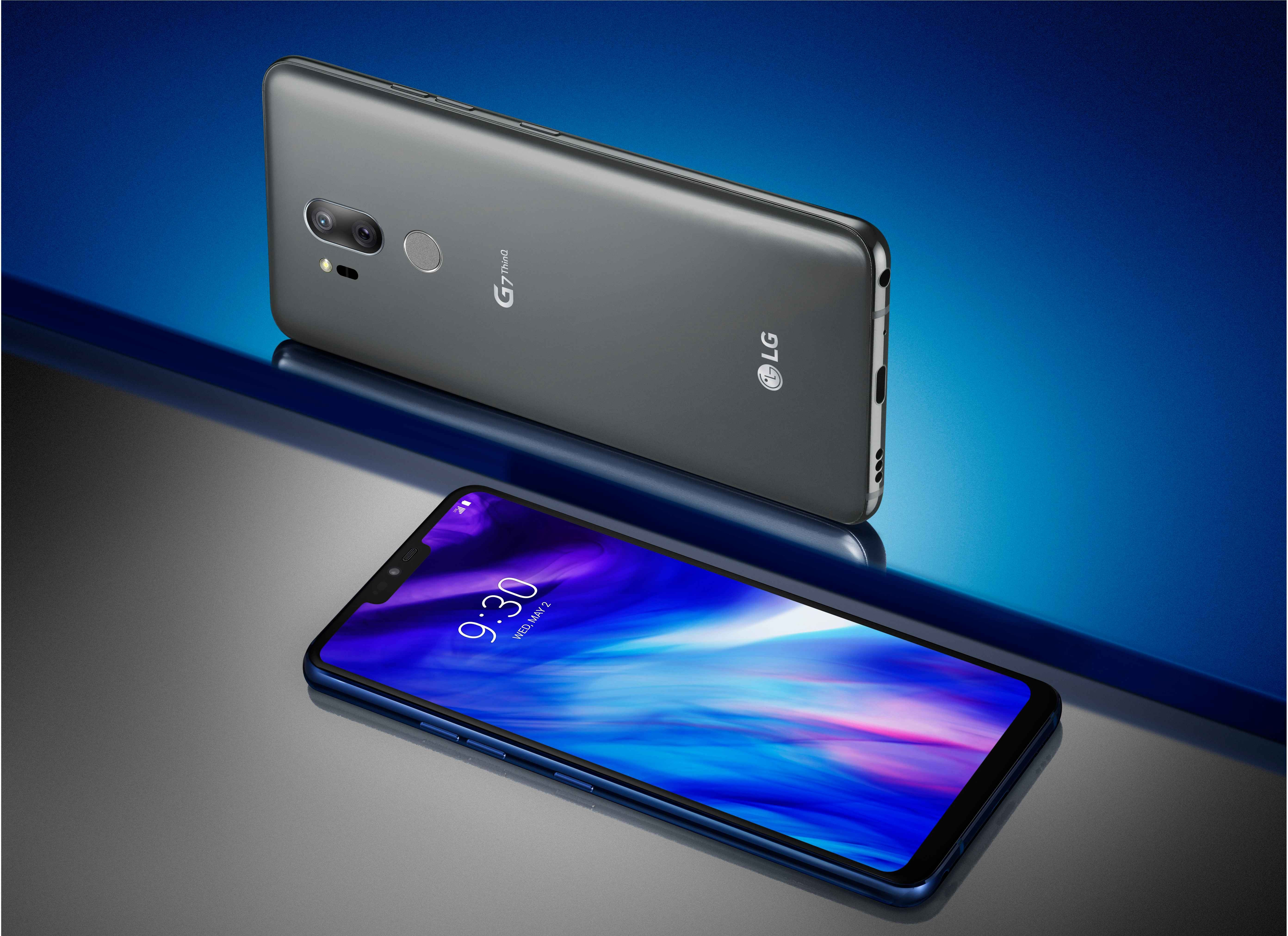 The front and rear view of the LG G7 ThinQ in New Platinum Gray against a gray and blue background