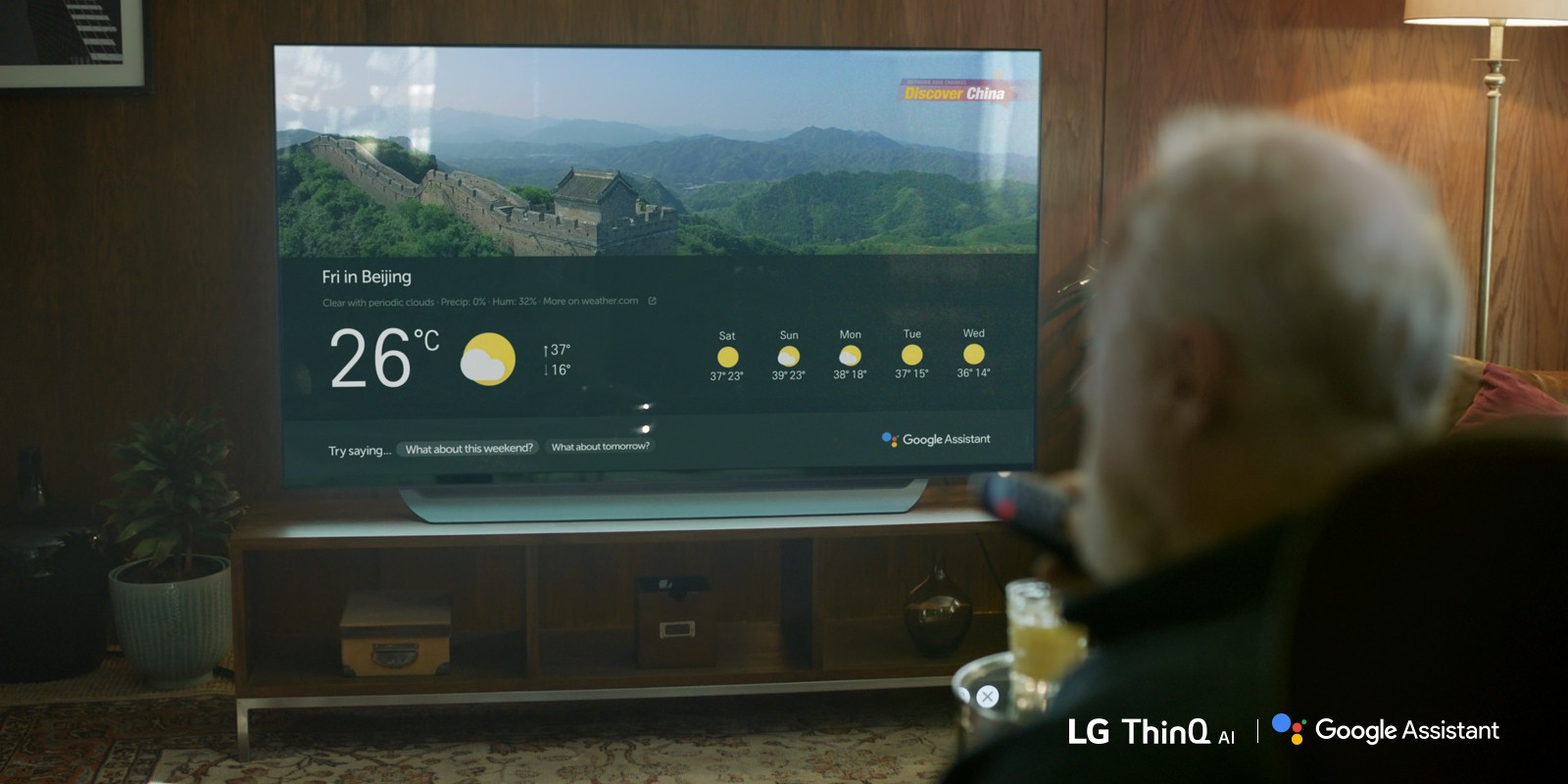 An elderly man checks the weather on his AI-enabled LG TV
