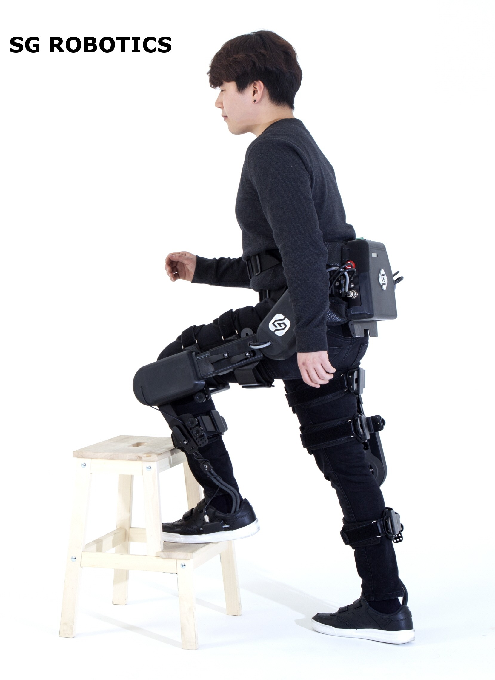 A model poses with SG Robotics equipment.