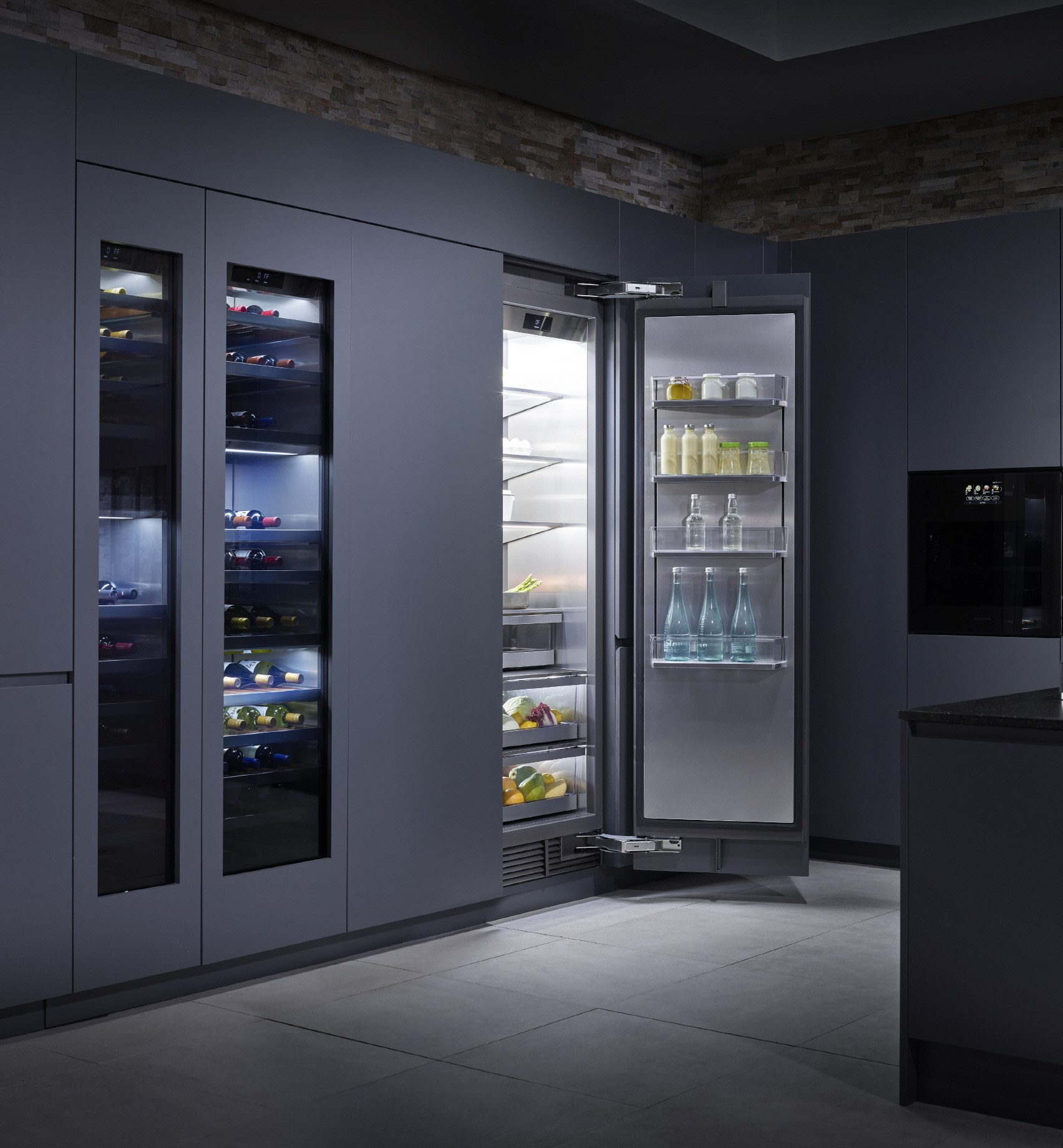 SIGNATURE KITCHEN SUITE refrigerator and wine cellar. The refrigerator opening its door and showing inside filled up with various bottles and foods.