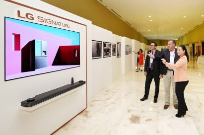 Delegates look at the LG OLED TV AI ThinQ.