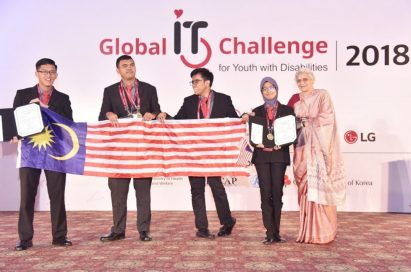 Challenge winners from Malaysia hold up their national flag and the award certificate.