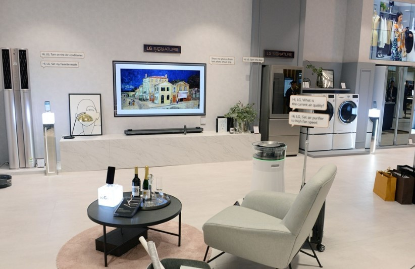 LG ThinQ AI-enabled products and a Natuzzi's Colosseo sofa are on display at the Smart Living Concept zone in Natuzzi Italia.